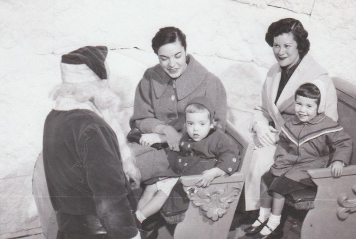 This picture of me; my mom; my aunt Doris and my cousin Johnnie. My mom and me are on the right. Doris is mom's sister and we were at Hudson's in downtown Detroit visiting Santa. The year of picture late 1950's or early 1960's as I was born in 1954.