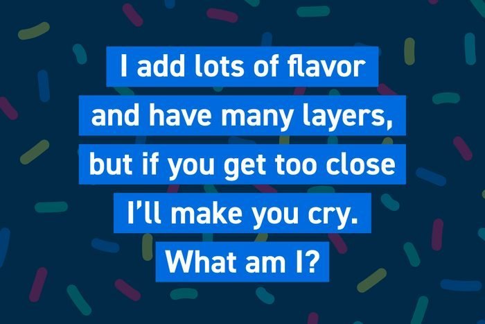 I add lots of flavor and have many layers, but if you get too close I'll make you cry. What am I?