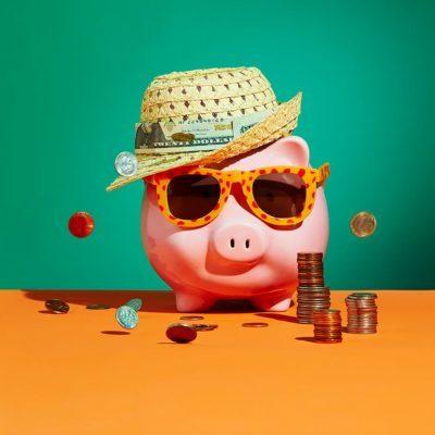 piggy bank in sunglasses and straw hat concept photography by ellen weinstein