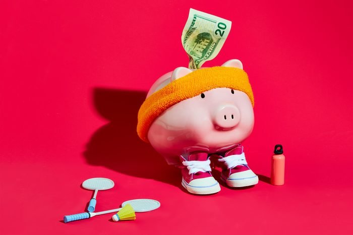 piggy bank wearing a sweatband and sneakers concept photography by sarah anne ward