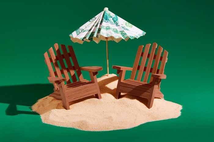 mini adirondack wooden chairs with money umbrella concept photography by sarah anne ward