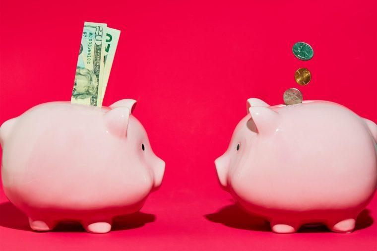 two piggy banks facing each other concept photography by sarah anne ward