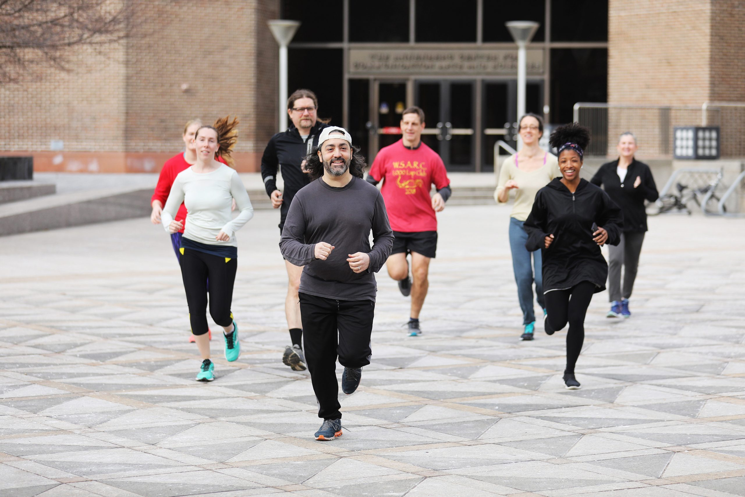 Mario Giorno (middle) and other members of The Annenberg Running Club