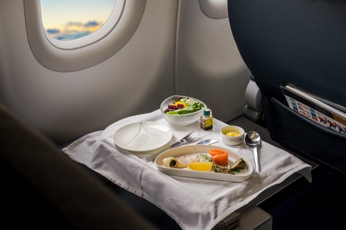 Food served on board of business class airplane on the table.