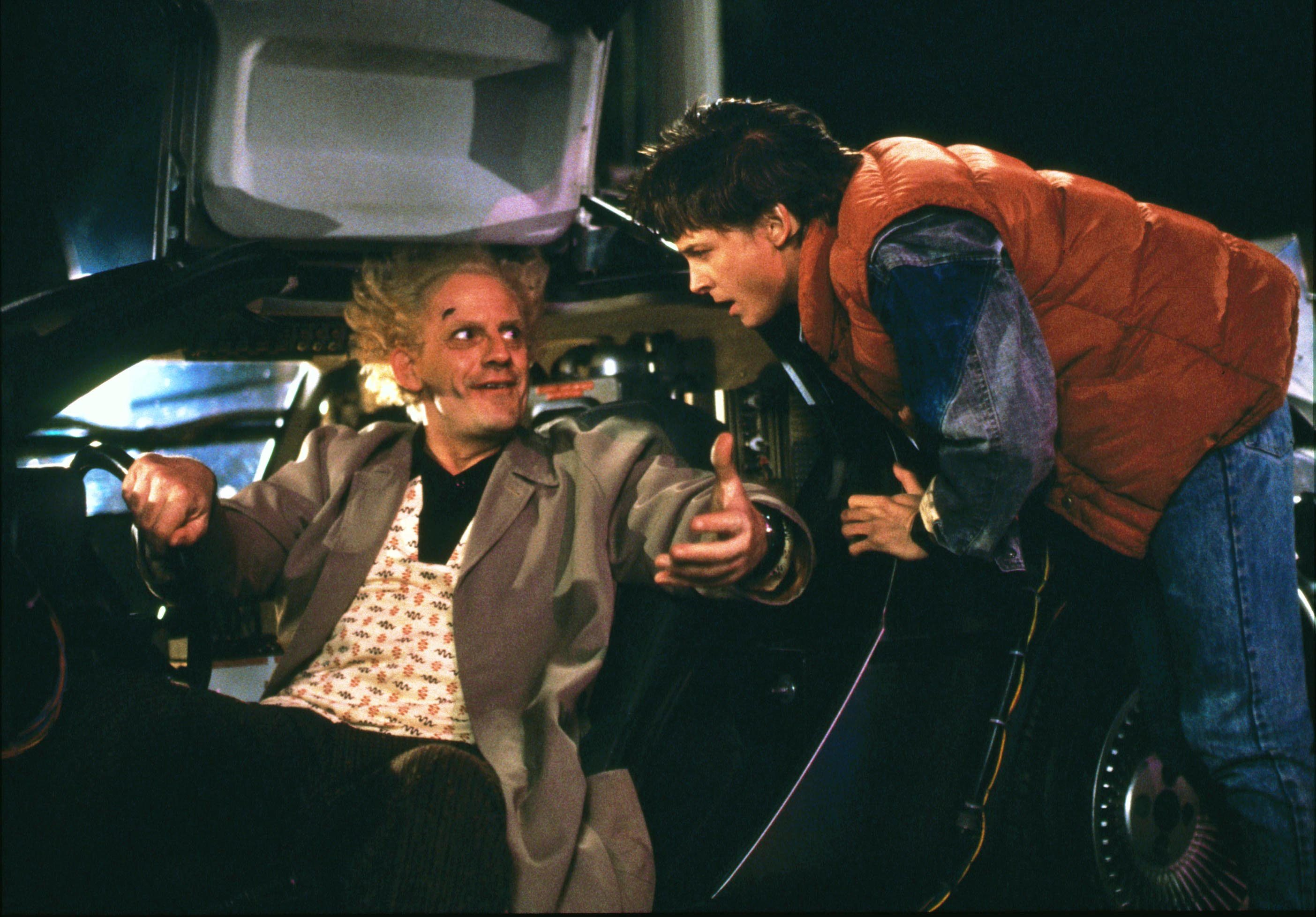 Editorial use only. No book cover usage. Mandatory Credit: Photo by Amblin Entertainment/Universal Pictures/Kobal/Shutterstock (5886092ab) Christopher Lloyd, Michael J. Fox Back To The Future - 1985 Director: Robert Zemeckis Amblin Entertainment/Universal Pictures USA Scene Still Scifi Retour vers le futur