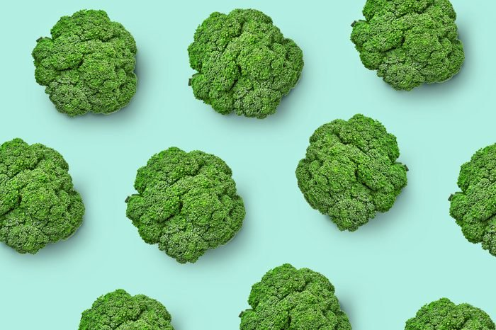 Broccoli cabbage on a colored background. Pattern of fresh broccoli cabbage. Top view of broccoli. Isolated