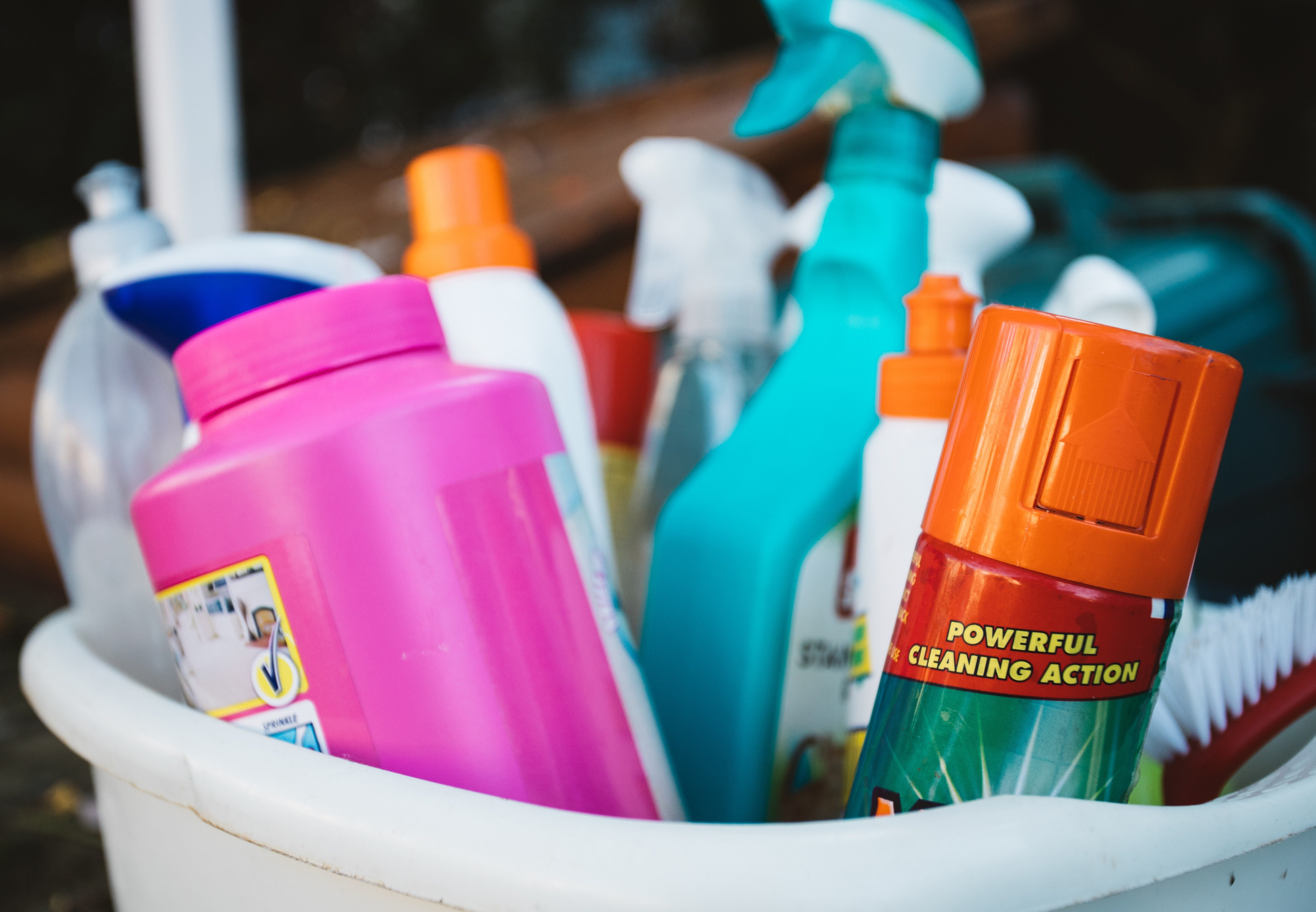 A basket full of cleaning products with the words powerful cleaning action on show