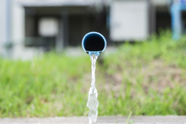 drainage water from pvc pipe (shallow DOF)