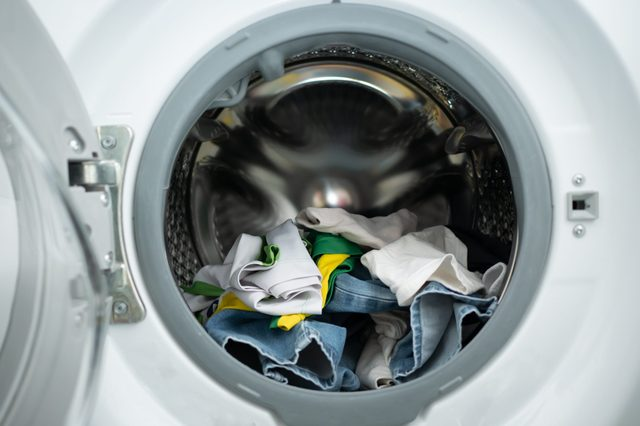 Dirty clothes in washing machine drum