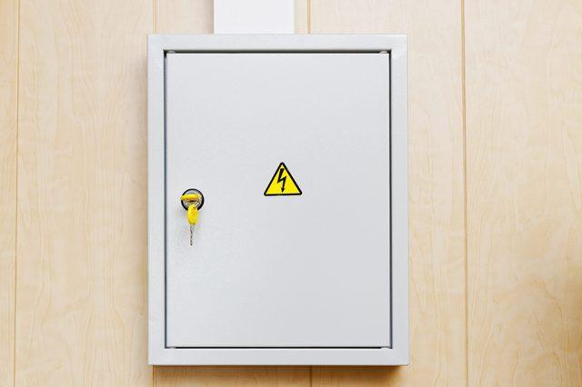 Grey Hinged Power Supply Box on the Wall