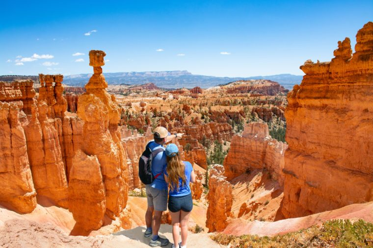 Couple on top of the mountain looking at beautiful landscape Friends enjoying time together on hiking trip. Father and daughter enjoying vacation. Bryce Canyon National Park, Utah, USA