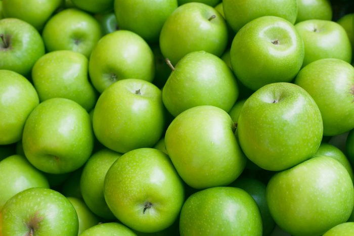 Apple. Green background.