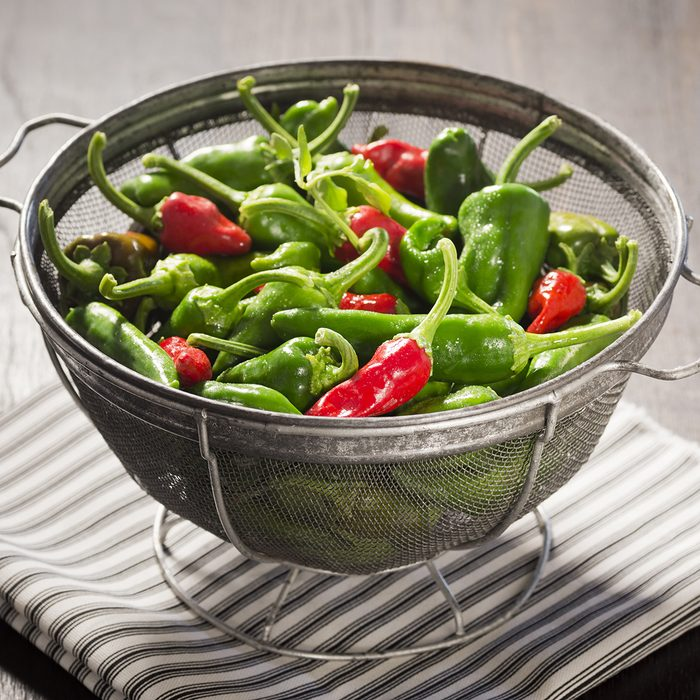 Green and Red New Mexican Chile Peppers in a Colander