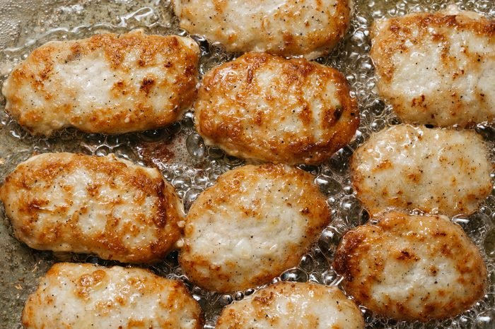 Meatballs frying in hot oil in a pan. Close up view.