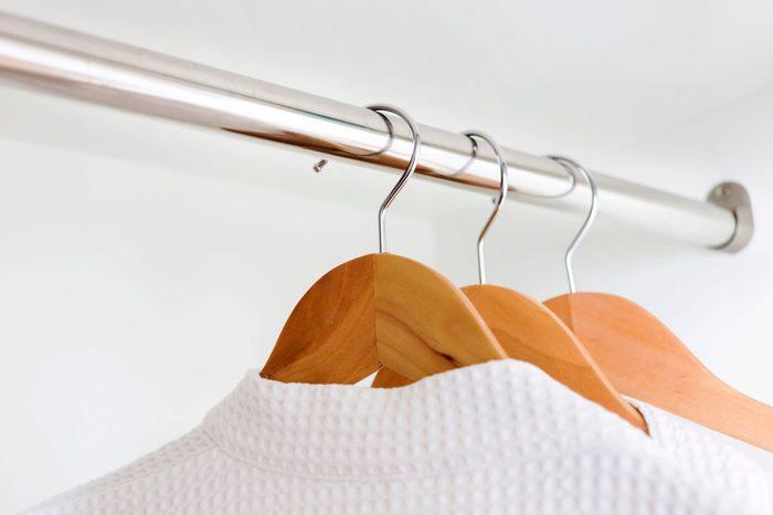 white bathrobes hanging in closet