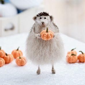 Handmade Hedgehog holding a pumpkin