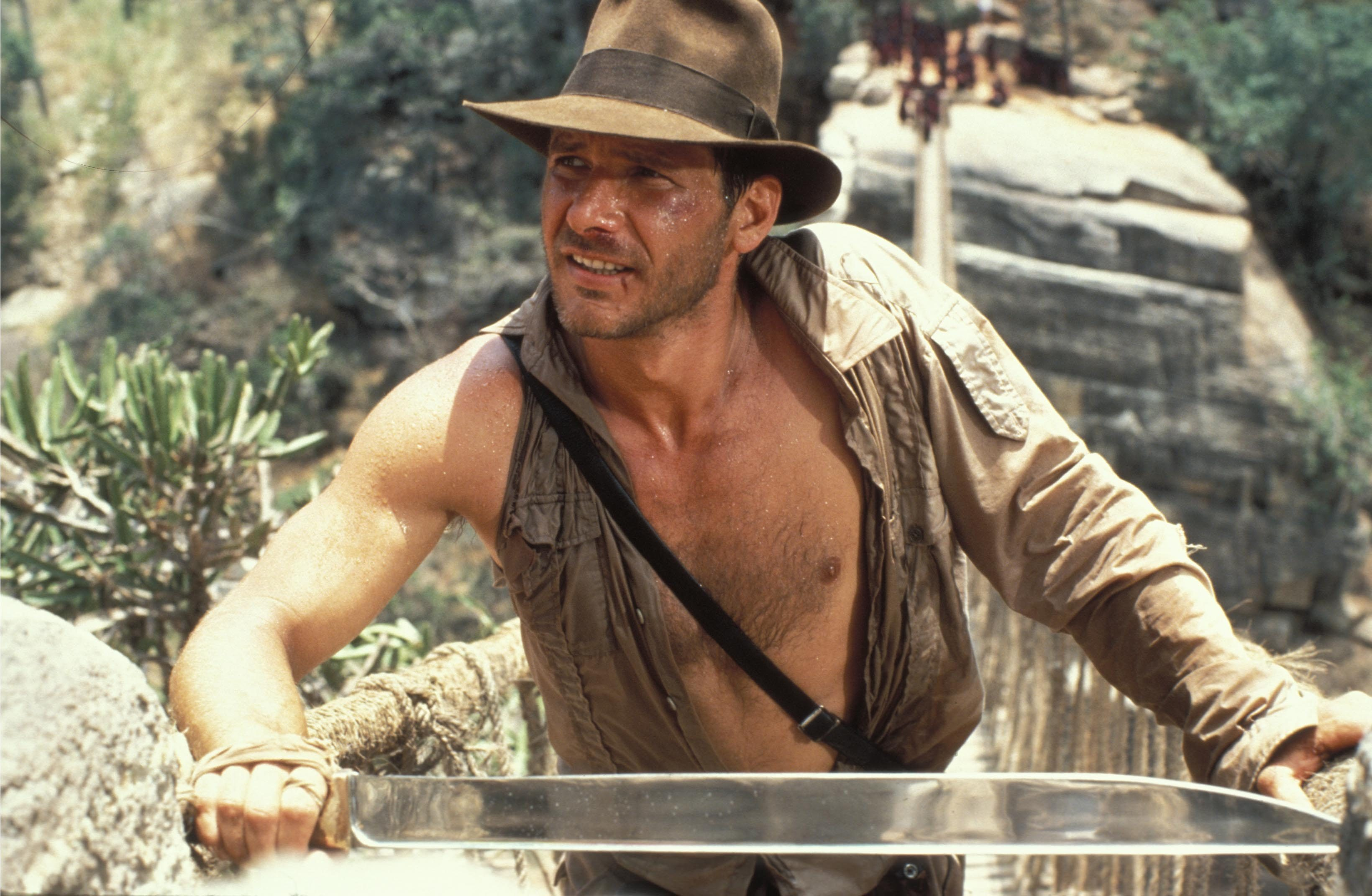 Editorial use only. No book cover usage. Mandatory Credit: Photo by Lucasfilm Ltd/Paramount/Kobal/Shutterstock (5886187c) Harrison Ford Indiana Jones and The Temple Of Doom - 1984 Director: Steven Spielberg Lucasfilm Ltd/Paramount USA Scene Still Action/Adventure Indiana Jones et le temple maudit