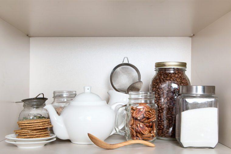 Sugar, tea , cookies and coffee beans for breakfast in pantry shelf