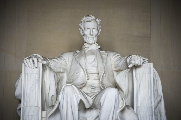 Iconic statue of Abraham Lincoln, sculpted by Daniel Chester French, is in the Lincoln Memorial in Washington DC.