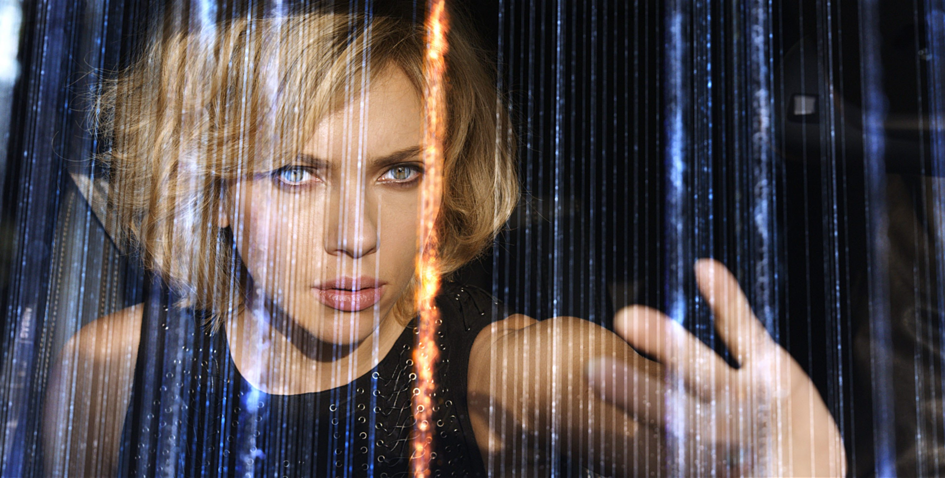 Editorial use only. No book cover usage. Mandatory Credit: Photo by Canal+/Universal/Kobal/Shutterstock (5882439o) Scarlett Johansson Lucy - 2014 Director: Luc Besson Canal+/Tf1 Films/Universal FRANCE/USA Scene Still Action/Adventure