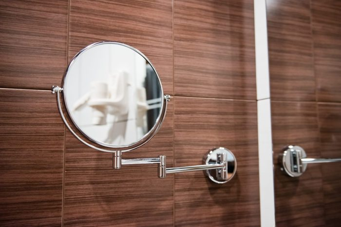 Round wall mirror for the bath.