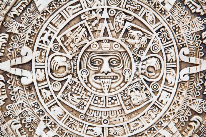 Fragment of the Mayan symbolic sun carved on the stone