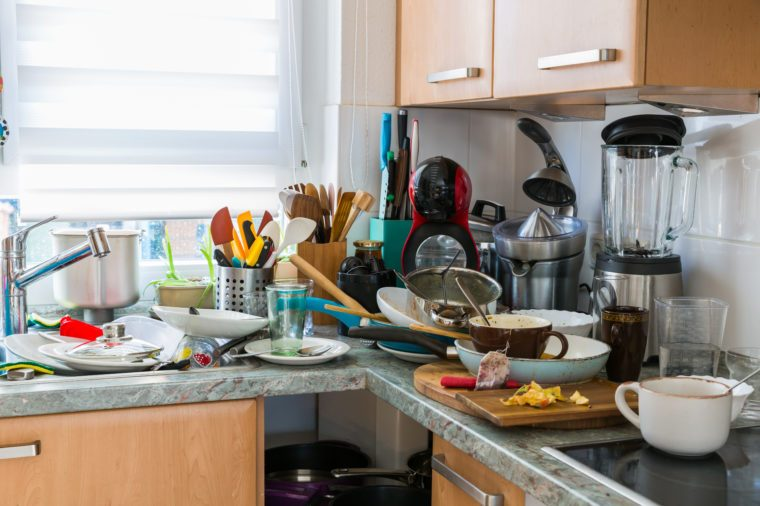 Compulsive Hoarding Syndrom - messy kitchen with pile of dirty dishes