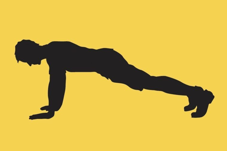 silhouette of a man in a push up position