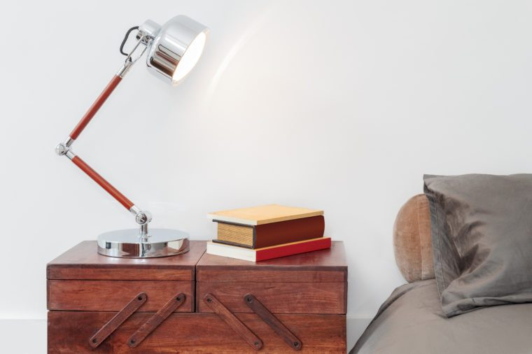 Retro Style Table With Lamp And Books