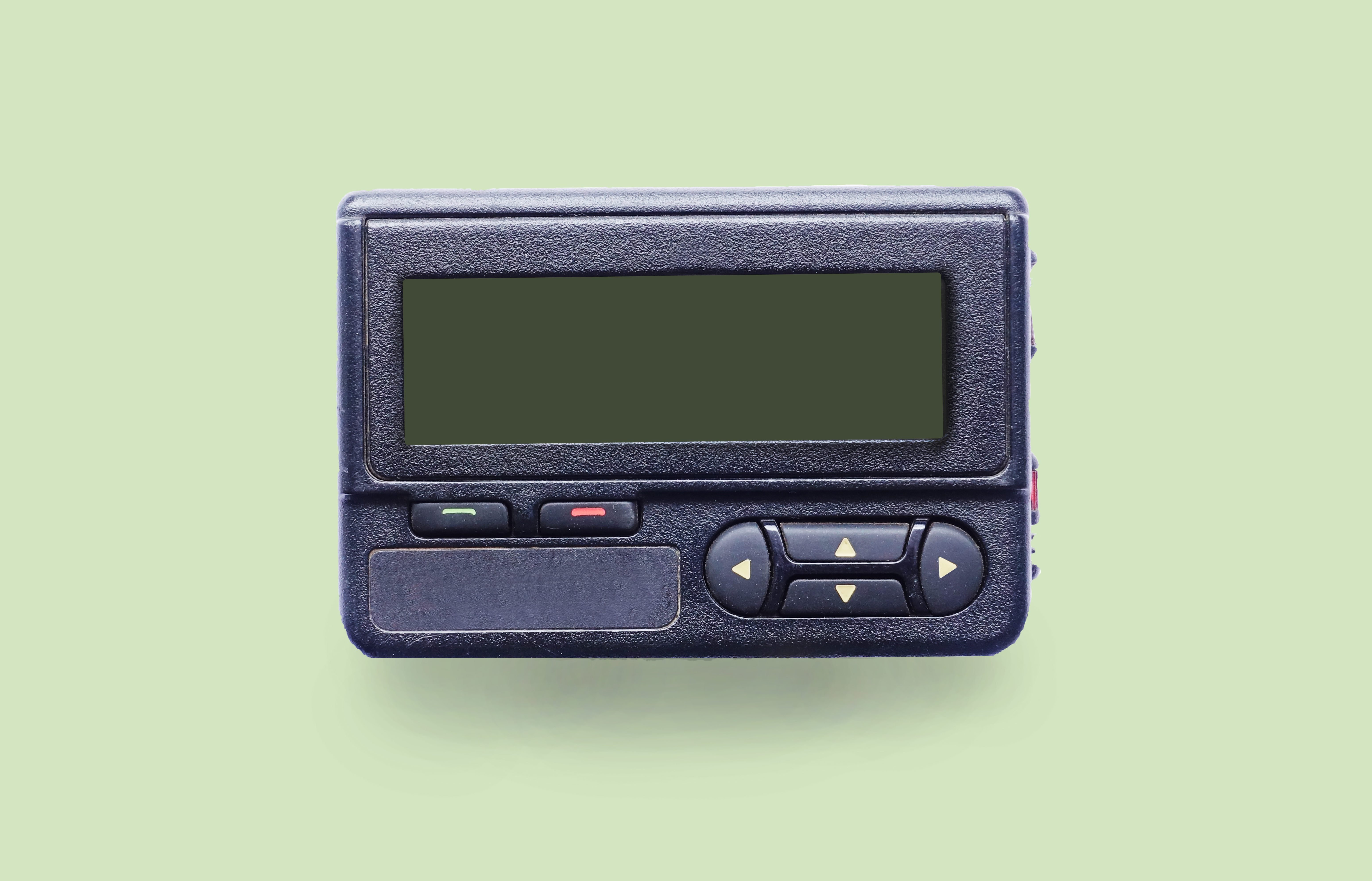 Old beeper or pager isolated on white background; Shutterstock ID 697663945; Job (TFH, TOH, RD, BNB, CWM, CM): -