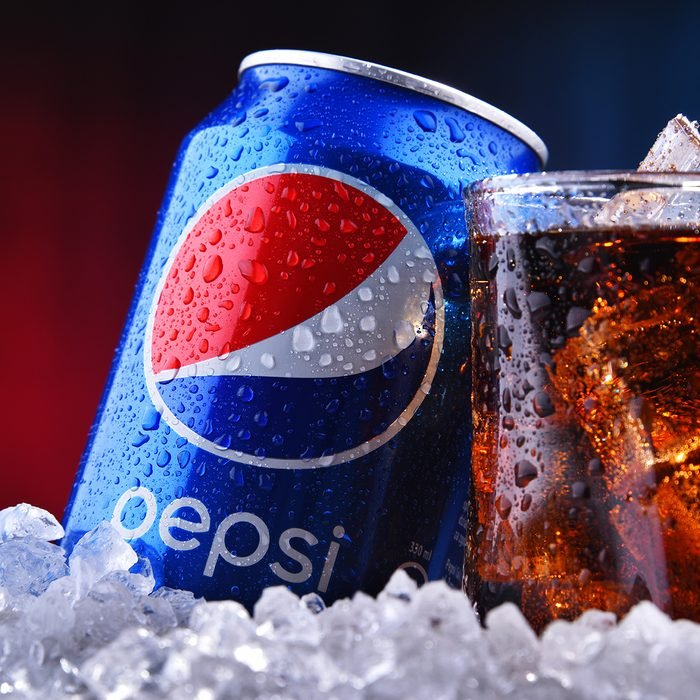 A can and a glass of Pepsi, a carbonated soft drink produced and manufactured by PepsiCo.
