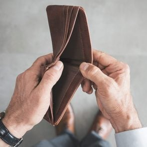 Man hand holding empty wallet