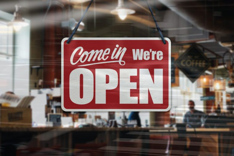 A business sign that says 'Come in We're Open' on Cafe / Restaurant window.