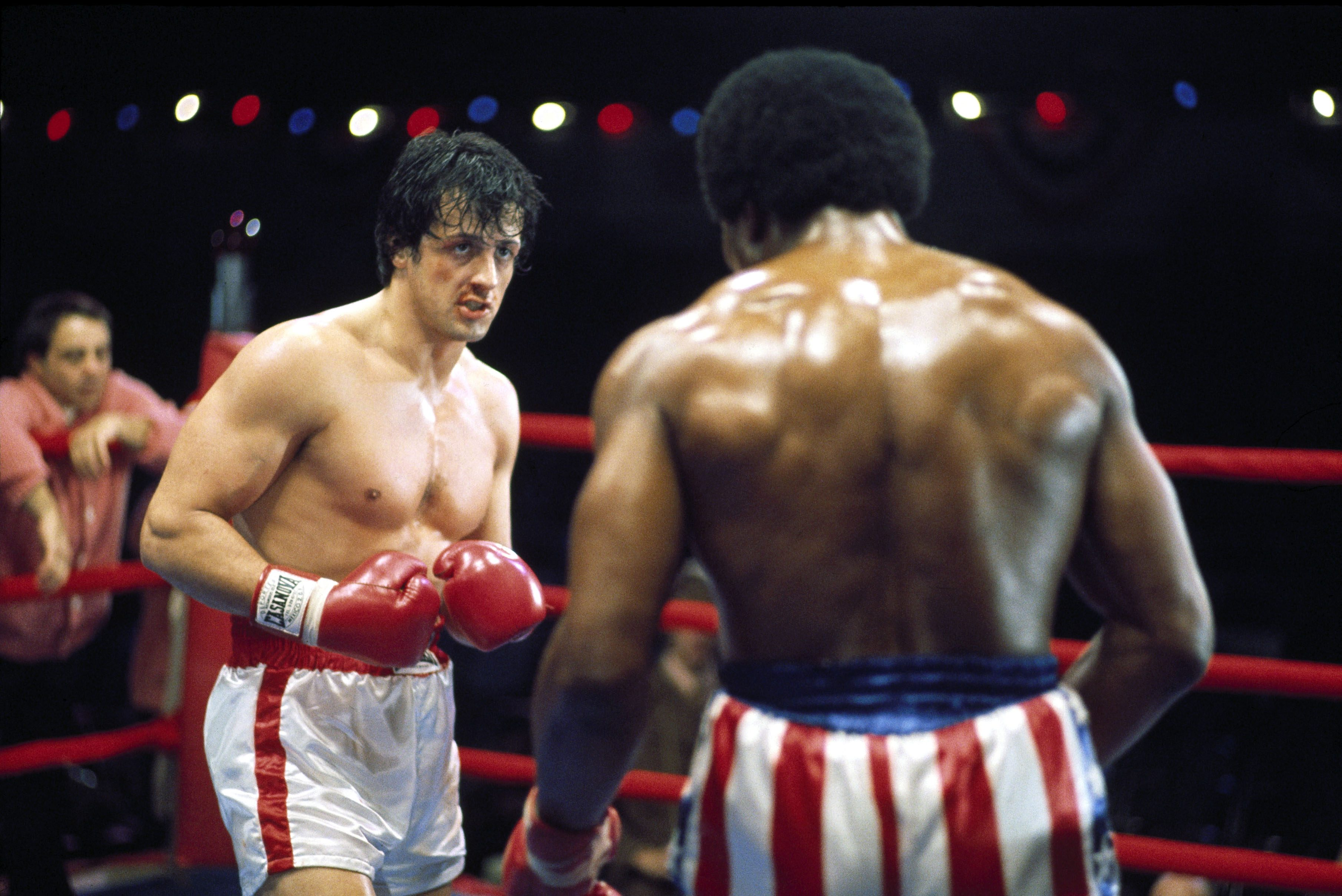 Editorial use only. No book cover usage. Mandatory Credit: Photo by United Artists/Kobal/Shutterstock (5885065x) Sylvester Stallone, Carl Weathers Rocky - 1976 Director: John Avildsen United Artists USA Scene Still