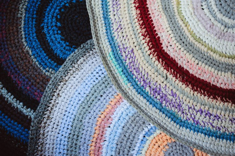 handmade Grandmothers carpets set made from old used clothes. Reuse and upcycling concept, zero waste, ecology in daily life