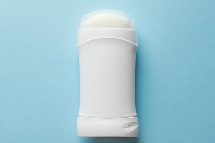 white deodorant on blue background. bath concept. place for text. copy space.; Shutterstock ID 1352140589; Job (TFH, TOH, RD, BNB, CWM, CM): -