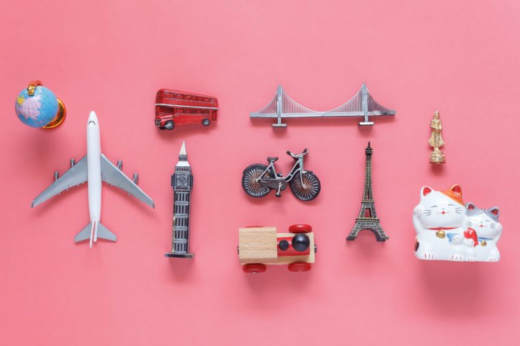 Flat lay aerial image of travel background concept.Table top view of souvenir symbol location or landmark of place for traveler all the world.objects on modern rustic pink paper.mock up & template.