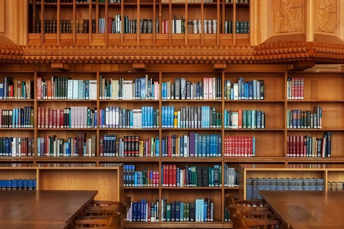 LEUVEN, BELGIUM - SEPTEMBER 05, 2014: Wooden bookshelves in the historical library of the Catholic University in Leuven. The library is National treasure of Belgium since 1987.