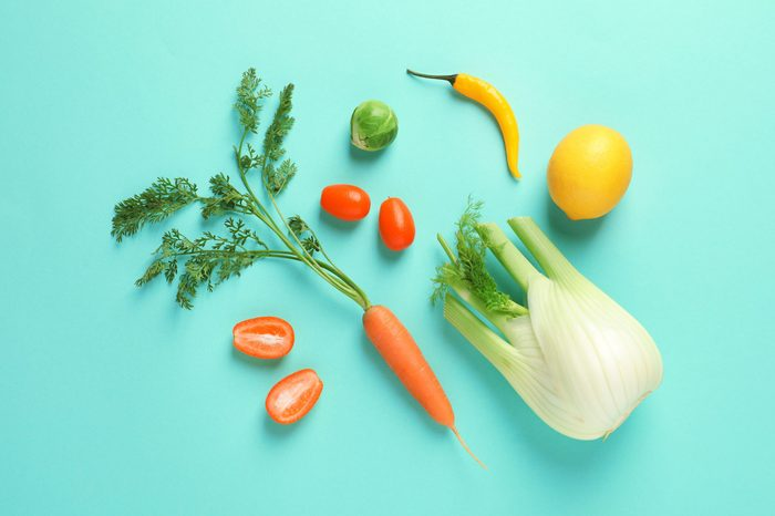 Flat lay composition with fresh fruits and vegetables on color background
