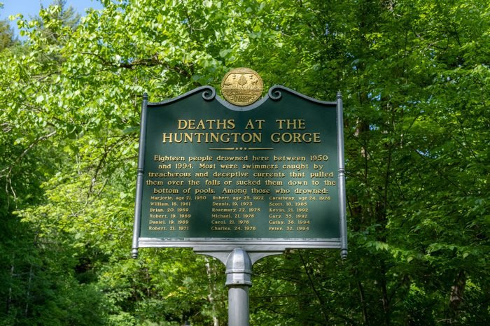 Huntington, Vermont, USA - June 8, 2018 - A sign listing people drowned at Huntington Gorge.