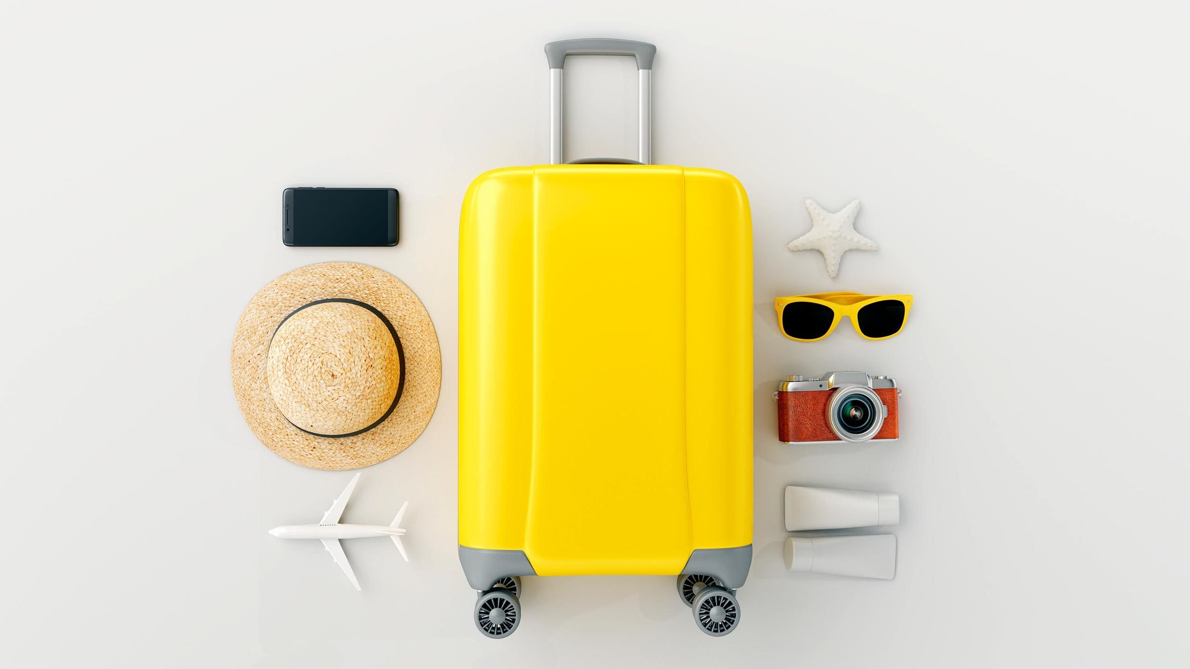 Flat lay yellow suitcase with traveler accessories on white bright background. travel concept