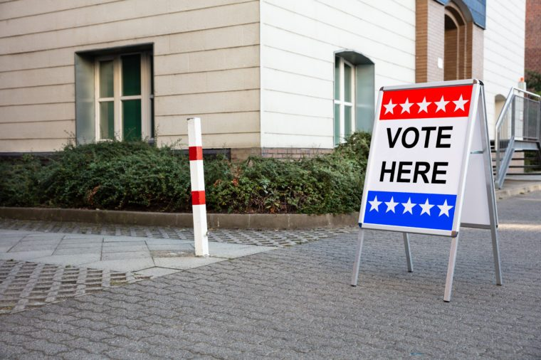 Polling Place Vote Here Sign On White Board Near House