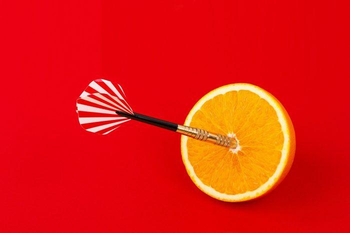Dart in the center of an orange.