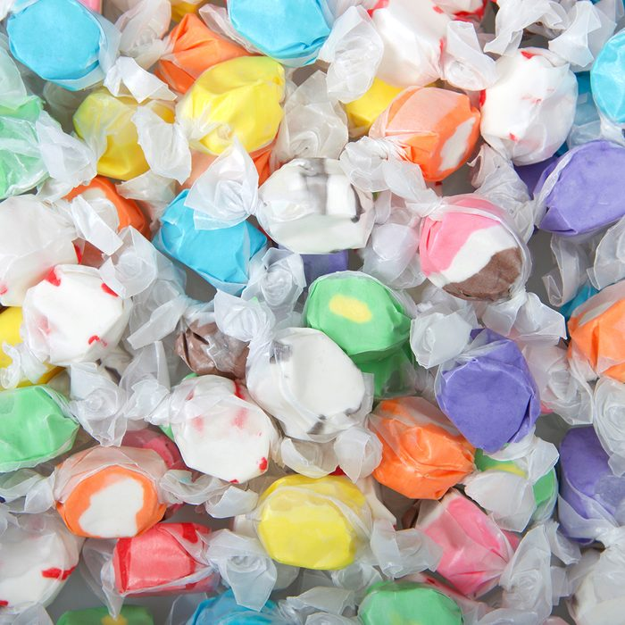 Background of salt water taffy in various flavors and colors wrapped in white transparent paper. Salt water taffy is sold widely on the boardwalks in the U.S. and Canada.; Shutterstock ID 1312539896; Job (TFH, TOH, RD, BNB, CWM, CM): Taste of Home