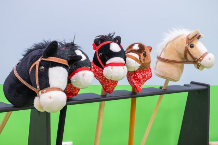 The row of multicolored hobbyhorses - children toys.