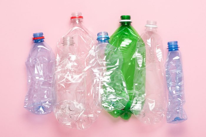 Plastic waste bottles top view. Eco plastic recycling concept.