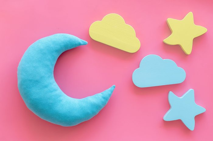 Sleep time concept with moon, stars on pink background top view