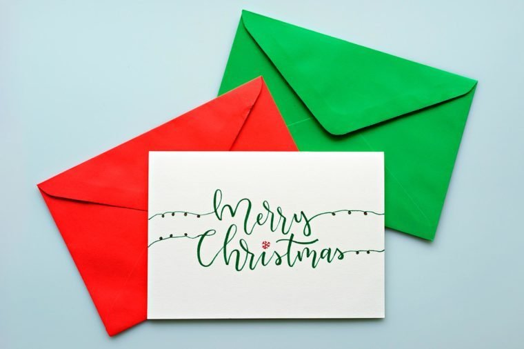 Top view hand drawn Christmas greeting cards with envelope.