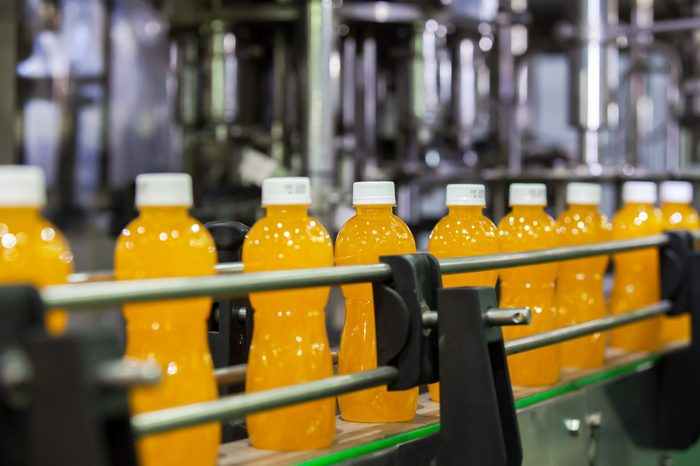 Orange Juice Bottles transfer on Conveyor Belt System