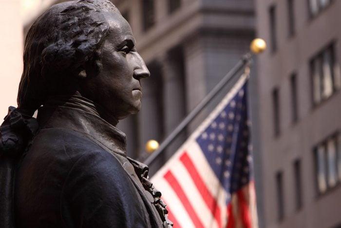 Close up on Statue of Washington on Wall Street